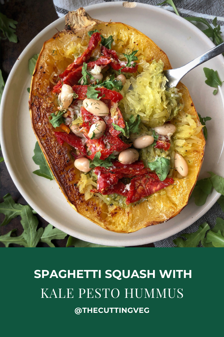 Spaghetti Squash with Kale Pesto Hummus might be a side dish, an appetizer, or an entree, but it is definitely a home run if you ask me! Once you try hummus on pasta (especially this hummus!) you might not go back!  #thecuttingveg #eatrealfood #pesto #spaghettisquash #healthyrecipes