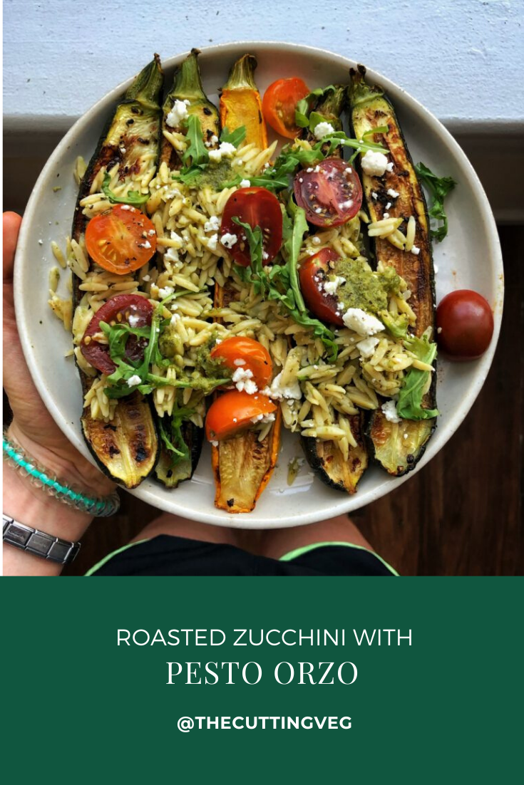 Roasted stuffed zucchini. A healthy vegetarian recipe of tomato, feta, and orzo stuffed inside a grilled pesto zucchini. This quick and easy dish is perfect for spring and summer days and doubles as a healthy dinner or simple side dish. #thecuttingveg #pesto #eatrealfood #veganrecipes #vegetarianrecipes
