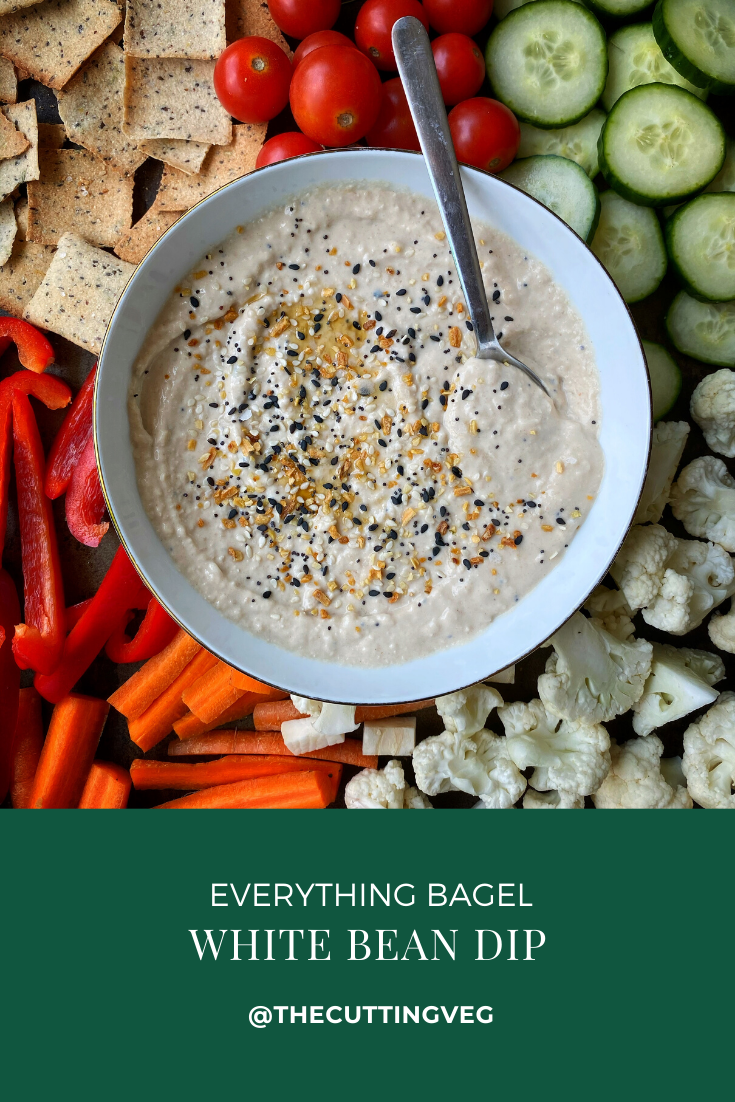 Everything Bagel White Bean Dip is the best little twist on your favorite bean based dip! Creamy white beans blended with sesame oil and plenty of spices, it is the best little appetizer for your next party! #thecuttingveg #eatrealfood #hummus #everythingbagel