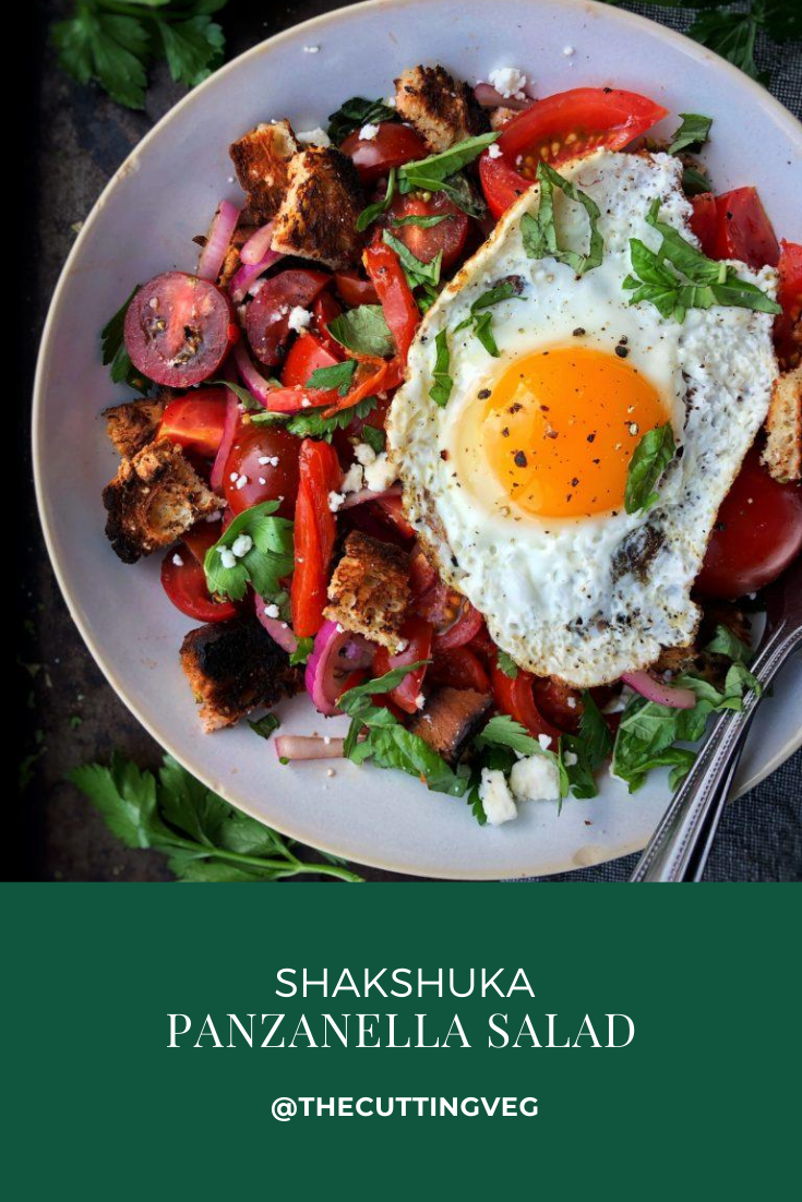 With summer tomatoes in full swing, this Shakshuka Panzanella Salad gives a fresh take on one of your favorite stew-ish delicious salads. Fresh tomatoes, roasted red peppers, and bread combined with herbs give you one heck of a fresh summer salad. Top with a poached, soft boiled, or fried egg for the perfect summer lunch or dinner! #thecuttingveg #eatrealfood #tomatoes #panzanella